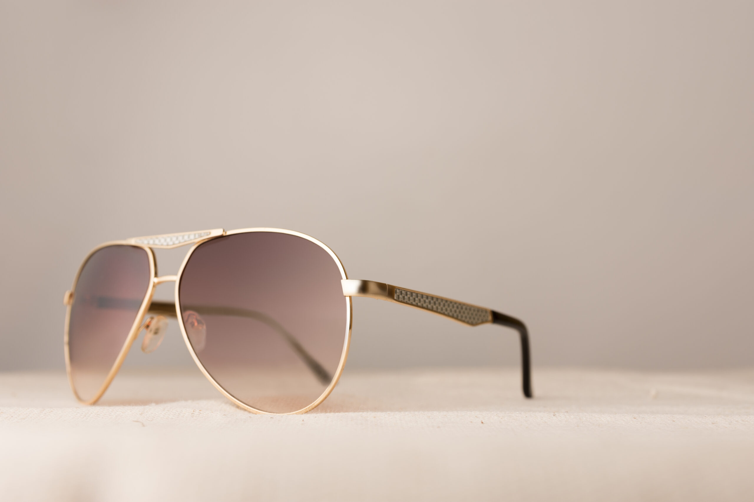 Fashionable ladies sunglasses on plain background with copy space for text.